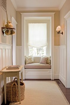 Wainscoting to the hallway & ceiling with a small window seat and wood floors & single window shade.. love it.