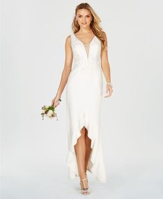 384385278d An undulating ruffle echoes the plunging neckline and looks chic while  walking on this entrance-making embroidered gown from Adrianna Papell.