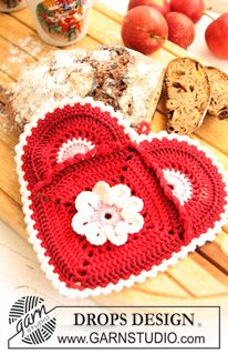 For 2 potholders:    Materials: DROPS MUSKAT from Garnstudio  100 g colour no 12, red  100 g colour no 41, bordeaux  50 g colour no 06, light pink  50 g colour no 08, off white    DROPS CROCHET HOOK SIZE 3 mm – or size needed to get 22 sts x 11 rows = 10 x 10 cm.