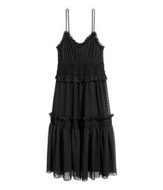 Black/dotted. Knee-length dress in dotted chiffon. V-neck at front, narrow, adjustable shoulder straps, and smocked seam at waist. Flared skirt with ruffle