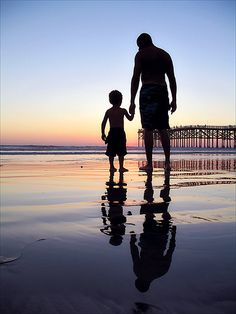 Perfect 'daddy and little boy' picture... Love the sunset, how it reflects off the water, the pier in the background, but that nothing takes away from that priceless bond shared between the parent and child. #kimberlingray