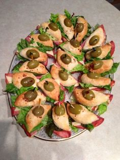 Kelly's Party Finger Sandwiches-Ham, Swiss cheese, lettuce and black and green stuffed olives with a honey mustard, mayo - on  pillsbury big country refrigerated biscuits.