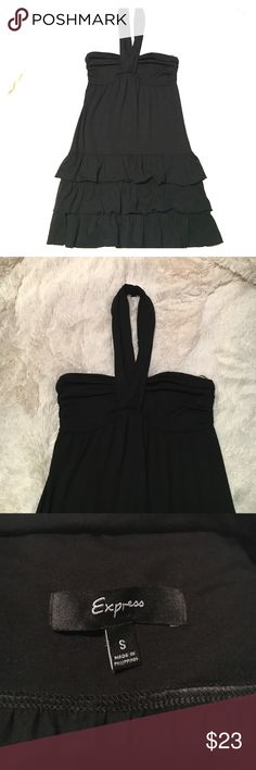 Express Halter Dress Size Small New without tags, never worn. Nice and super cute! Has a middle strap that goes around the neck like halter style. Perfect condition,no flaws. Comfy, dress up or down. Express Dresses Backless