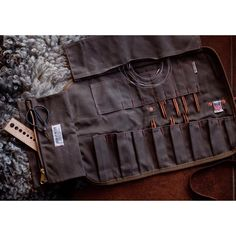 Tool Roll from Iron & Resin http://ironandresin.com/collections/tools-outdoors/products/inr-tool-roll?variant=4113113797 used as a knitting needle organizer/case.  Made with leather and Martexin--nothing of the froufrou here.