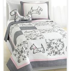 Nothing can ever be cuter than this stylish french dog design quilt set with embroidery patchwork patterns of gingham and floral toile embellishing. This set features a patterned border with grey pink trimming in 100-percent cotton.