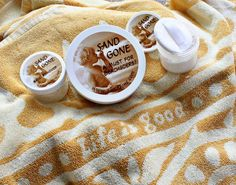 A must for the beach! Sand Gone - a dry powder that comes with a puff and removes sand and smells like coconut!