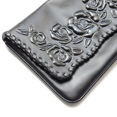 Embossed floral leather clutch: Sean Rock | Anne Fontaine