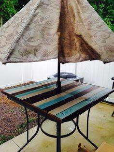 Shattered glass patio table fixed with ply board and some pallets, stained, and sprayed with a weather proof spray!