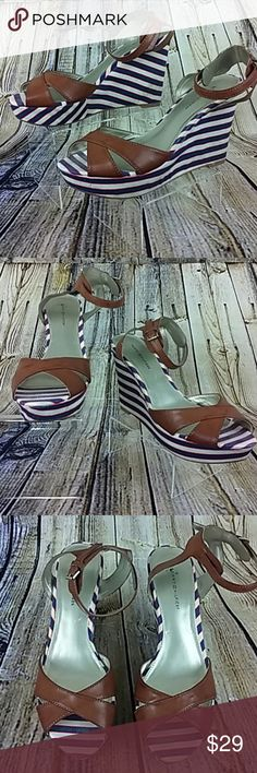 Tommy Hilfiger Wedge Sandal Ankle Strap Tommy Hilfiger Wedge Sandal Ankle Strap with Stripe Pattern.  Heel height is 5 inches. Gently used. Medium width.  Thank you for checking out this item. Please feel free to check out my closet. Tommy Hilfiger Shoes Sandals