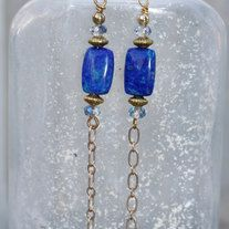 Lovely lapis earrings paired with Chinese crystals. Lapis rounds dangle from 14k gold chain. Gold plated spacers, eye pin and gold plated surgical steel ear wire. 3 1/4 inches from top of ear wire to bottom of dangle. Comes wrapped in tissue in a gift bag ready for gift giving!