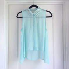 Sheer Key Hole Tank Fun, edgy, blue, spiked collar sleeveless top. See-through, flowy and tapered on the sides. Buttons in the front and a cut out on the upper back. Forever 21 Tops Tank Tops