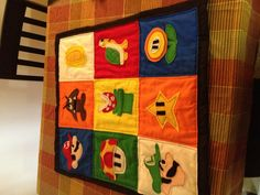 Baby Quilt for Mario themed bedroom! Used felt for the characters.