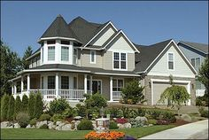 I love houses with wrap around porches and stone accents