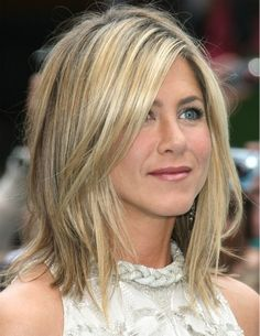 ...texturized and layered shoulder length hairstyle that soft and lovely for any face.