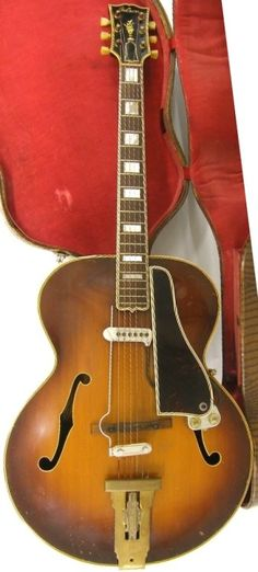 circa 1940 Gibson L5 hollow body Guitar with an aftermarket but possibly contemporary pickup fitted  Lardys Chordophone of the day 2017  --- https://www.pinterest.com/lardyfatboy/