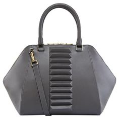 This breathtaking bag brings together classic style and innovative design. Handmade with precision cut calfskin leather, the geometrical detail work on the front gives the Izabelle Top Handle an exquisite and distinctive look and feel.
