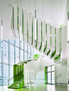 Segmented covered, yet internal staircase, with green interior and white exterior. Via knstrct.com