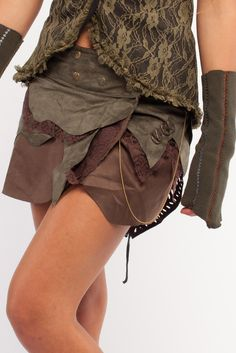Steampunk fake leather wrap mini skirt with multiple layers. Closes with pop buttons. Goa Trance, Steampunk, Psytrance, Hippie,Boho,Tribal festival clothing. Pocket belts, hats and arm Warmers.Come visit our shops in Camden and Greenwich Markets http://gekko-london.com/style-gallery/25/74/544