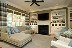 Small Family Room Decorating Ideas With Contemporary Interior Design Using Traditional Fireplace With Brown Wall Color