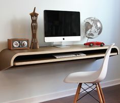 A minimalistic floating desk gives this office a sleek look