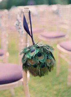 Peacock kissing balls for ceremony decor.