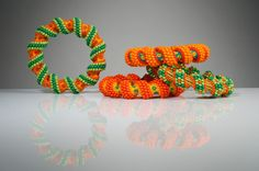 Orange Peyote Spiral Bracelets. Tubular, Spiral Peyote Stitching    © 2013 Suzanne Golden