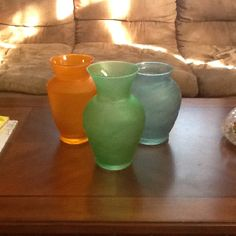 Painted clear vases with Elmer's Glue and food coloring.