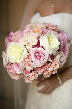 A pink and yellow rose round bouquet | Brides.com