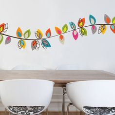 Love this decal design on the wall. Happy colors!