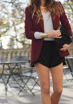 Burgundy blazer, black shorts, gray long sleeve shirt and gold accesories