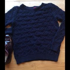 Tommy Hilfiger navy blue knit sweater Heavy knit sweater from Tommy Hilfiger. 100% cotton. Only worn once and has been washed once on delicate cycle, and dried with no heat to prevent shrinking. Very nice sweater with a unique knit pattern. Would look nice with a white collared shirt and jeans. Tommy Hilfiger Sweaters Crew & Scoop Necks