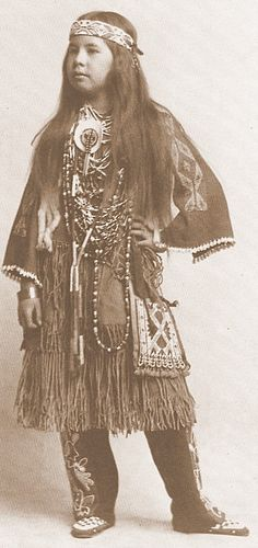 proud young native Indian girl in traditional attire of her tribe. old photo. XIX century.