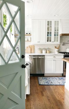 Kitchen with Robin's egg blue door paint color - House tour and paint color on Home Bunch Blog