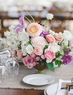 whimsical pink centerpieces with ranunculus, lilac + roses