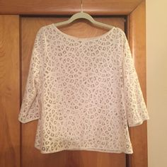 Loft Blouse White LOFT blouse with amazing pattern. Must be worn with a cami underneath. Elbow length sleeves. Worn only a few times. In great condition. LOFT Tops Blouses