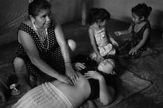 Midwife Elsa Gonzalez Ayala shows CASA Midwifery School students how to perform a traditional Mayan massage used to shrink a woman's uterus and reduce postpartum bleeding. The students traveled to Chunhuhub, Quintana Roo, Mexico to learn traditional midwifery.