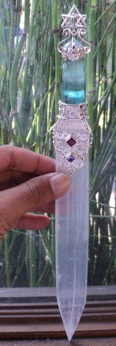I have a selenite piece that looks just like this. Add the silver and a hilt and I could make it a sword!!