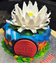 Lotus flower cake. Lotus flower symbolize peace, purity and many, many more years to come. Perfect for a 1 year old cake theme. Enquiry can be made via www.facebook.com/BabyBerryC