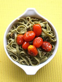 These roasted tomatoes tossed with some spinach noodles are such an easy supper!