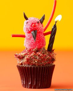 Little Devil  To make this delicious devil, you'll need two red gumdrops, red licorice for his arms and tail, black licorice for ears and beard, and two black sprinkles for the eyes. A black candle serves as this trickster's flaming staff.