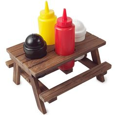 Picnic Table Condiment Set -- Add some excitement to your next family picnic or liven up your mundane dinner table by serving up your condiments in this awesome Picnic Table Condiment set! This 5 piece condiment set includes: 1 Salt Shaker, 1 Pepper Shaker, 1 Mustard Squeeze Bottle, 1 Ketchup Squeeze Bottle and 1 Mini Wooden Picnic Table. When put together this Retro Picnic Table measures 7.25 inches long x 4.75 inches wide x 7.5 inches tall.