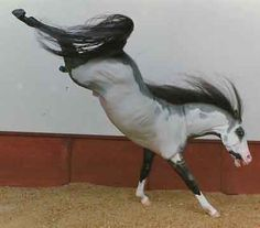 Would you believe that this is a customized Breyer model horse?  Nicely done!