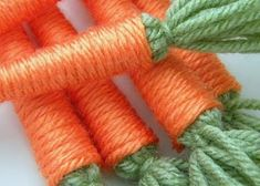DIY yarn carrots would be a sweet embellishment to an Easter basket.  After Easter they would be a fun addition to a play kitchen.