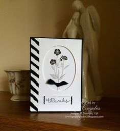 handmade card: Black and White ... Wild About Flowers ... great framing look with oval cut out window ...