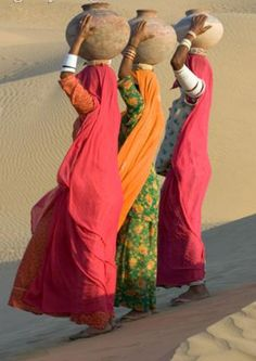 women carrying jugs of water atop heads, Jaisalmer, Rajasthan, India | Fotosearch