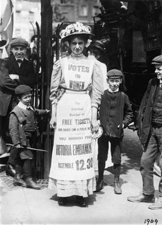 When life hands you stiff, uncomfortable apparel, make a pro-suffrage billboard.