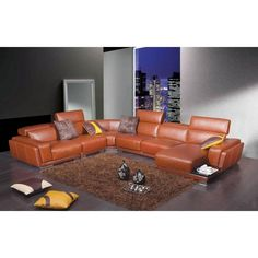 """Divani Casa 2996 - Modern Orange Leather Sectional Sofa. Modern sectional sofa setRetractable headrestsSide ledge on chaise for drinksAvailable in speical order colors (6-8 weeks) Dimensions: LAF 1 seater: W37""""xD40""""xH27""""  Corner: W64""""xD40""""xH27""""  Armless 1 seater: W28""""xD41""""xH27""""  Armless 2 seater: W55""""xD41""""xH27""""  LAF Chaise: W38""""xD60""""xH27"""" Color: Brown Finish:   -"""