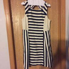 DKNY Navy/Beige Striped Dress, Size 14 DKNY navy/beige striped dress that was worn only once. The material is 60% viscose, 27% polyester and 13% nylon. DKNY Dresses Midi