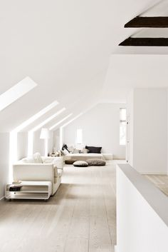 Light filled, using white throughout prevents the low ceiling becoming oppressive. Carries the eye through