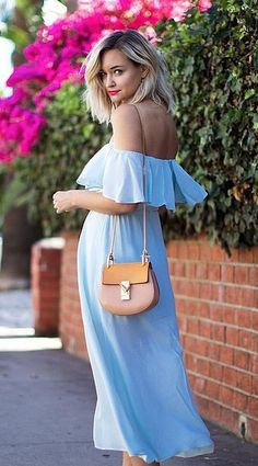 A Saddlebag Purse Paired With a Blue Dress